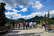 Tourists at the Teklanika River viewing point, Denali National Park, Alaska, while using the shuttle bus...