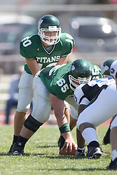 15 September 2007: Kraig Ladd sets to take the snap from Eric Van Hise.  The Titans stood toe to toe with the 25th ranked Lions through the first half but ended the game on the losing end of a 25-15 score at Wilder Field on the campus of Illinois Wesleyan University in Bloomington Illinois.