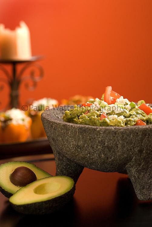 Guacamole in mortar with avocado