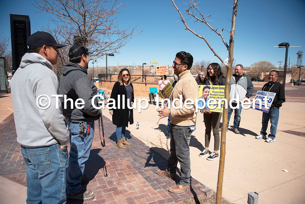 Jayson Gomez and Janell Griego campaign outside the McKinley County Courthouse Tuesday, March 3 as voters cast their ballots for the 2020 Municipal Officer Election in Gallup.