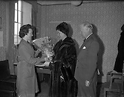 German Ambassador visits Glen Abbey Textiles..1962..06.02.1962..02.06.1962..6th February 1962..The ambassador of the Federal Republic of Germany, .H E Dr Adolph Reifferscheidt and his wife paid a visit to Glenabbey Textiles in Tallaght , Dublin today for a tour of the premises...Image shows Dr and Mrs Reifferscheidt being presented with a bouquet by Miss Una Kinsella on their visit to Glenabbey.