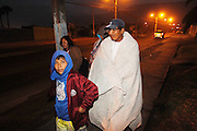 April 2, 2014 - Iquique, Chile - <br /> <br /> 8.2 Earthquake Hits Chile's Northern Coast<br /> <br />  People outside on the streets after an earthquake near Iquique of Tarapaca Region, north of Chile. An 8.2-magnitude earthquake hit off the northern coast of Chile Tuesday, leaving 6 people dead while thousands of people have been evacuated due to a tsunami alert.<br /> ©Exclusivepix