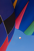 Hot air balloons ascend into the sky.<br />