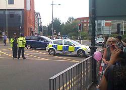 © licensed to London News Pictures.WATFORD, UK  02/06/11. EYEWITNESS PICTURE. Armed police arrive at the scene. Armed police are in a stand-off with a man threatening staff at a bank..A cordon was put in place around the Co-op bank, in Market Street, Watford, as Hertfordshire police attempt to contact the suspect.. Please see special instructions. Photo credit should read LNP
