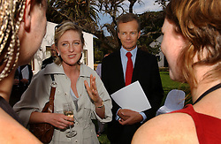 STELLENBOSCH, SOUTH AFRICA - Princess Astrid and Pierre Labouverie , Belgian Ambassador to South Africa, speak with Belgian students Lieve Vanleeuw, 26, of Limburg, and Evelien Storme, 21, of Mechelen, who are attending Stellenbosch University. All undergraduate classes are taught in the Afrikaans language at Stellenbosch. The graduate level courses are taught in English.  (PHOTO © JOCK FISTICK)<br />