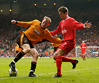 Photo. Jed Wee.<br /> Liverpool v Wolverhampton Wanderers, FA Barclaycard Premiership, Anfield, Liverpool. 20/03/2004.<br /> Wolves' Mark Clyde (L) holds off Liverpool's Harry Kewell.
