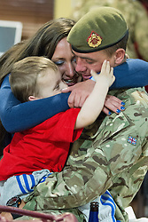 © Licensed to London News Pictures . 25/04/2013. Catterick Barracks , North Yorkshire , UK . Stephen Rumble (Dad , 26) hugs son Stephen Rumble Jnr (2) and Mum Jayne Eaton (23) (from Liverpool) . Soldiers from the 1st Battalion , the Duke of Lancaster's Regiment (1 Lancs) arrive at Catterick Barracks to be greeted by their families this evening (Thursday 25th April), following a six month tour in Lashkar Gah , Helmand Province , Afghanistan . With the UK combat mission due to complete by the end of 2014 , this is likely to be the last deployment by 1 Lancs in Afghanistan , the British Army reports . Photo credit : Joel Goodman/LNP