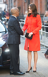 Catherine, Duchess of Cambridge, wearing a red Boden coat, visits Great Ormond Street Hospital in London