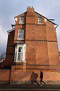 Red brick end house in Moseley on 5th January 2021 in Birmingham, United Kingdom. Moseley is an area where individual and grand homes were built  by industrialists in the early 1900s. Moseley and the surrounding areas were much developed after 1910, the new properties being mostly of large houses, designed to cater for the Edwardian middle-class families that settled in the suburbs surrounding Birminghams industrial centre.