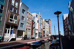 Modern apartment buildings beside canal in Java Island district of Amsterdam The Netherlands