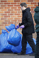 © Licensed to London News Pictures. 21/03/2018. Salisbury, UK. Police are seen removing bags of waste from the back of the Mill pub after Investigators from the Organisation for the Prohibition of Chemical Weapons (OPCW) have completed their work. Former Russian spy Sergei Skripal and his daughter Yulia were poisoned with nerve agent after visiting the Mill Pub in Salisbury. The couple where found unconscious on bench in Salisbury shopping centre. A policeman who went to their aid is currently recovering in hospital. Photo credit: Peter Macdiarmid/LNP