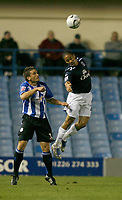 Photo: Steve Bond.<br />Sheffield Wednesday v Everton. Carling Cup. 26/09/2007. Steven Pienaar (L) outjumps Peter Gilbert