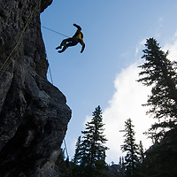 Chris Neve jumps on a rope at Rundle Rock near Banff, Alberta, in Canada's Banff National Park.