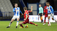 Huddersfield Town's Harry Toffolo evades the challenge from Reading's Michael Morrison<br /> <br /> Photographer Rich Linley/CameraSport<br /> <br /> The EFL Sky Bet Championship - Saturday 2nd January 2021 - Huddersfield Town v Reading - The John Smith's Stadium - Huddersfield<br /> <br /> World Copyright © 2020 CameraSport. All rights reserved. 43 Linden Ave. Countesthorpe. Leicester. England. LE8 5PG - Tel: +44 (0) 116 277 4147 - admin@camerasport.com - www.camerasport.com