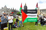 London, United Kingdom, June 26, 2021: People supporting the Palestinian cause are gathered outside the Westminster Palace, Parliament Square on Saturday, June 26, 2021 - demanding an end of colonial occupation of Palestine. Other protestors also descended into Parliament Square and some others later joined a musical rave gathering in Hyde Park near Marble Arch. (VX Photo/ Vudi Xhymshiti)