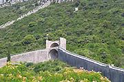 The Ston fortress built in the 14th century, and part of the 5 km long wall. Peljesac Peninsula. Ston. Peljesac peninsula. Dalmatian Coast, Croatia, Europe.