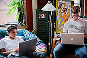 Ross Caputi, 27, (right) is working on his computer next his his wife, Dahlia Wasfi, 40, whose father is Iraqi, in a community centre in Boston, MA, USA. Ross just completed a course in linguistics from Boston University. He was a radio operator for his company in Fallujah in 2004, during the battles. After leaving the Marines, he turned to anti-war activism. Ross runs a project called 'Justice for Fallujah', which aims at raising awareness about the problems in Fallujah since the 2004 US-led battles, and about the wrongs of war, after having witnessed them first-person as a soldier in Iraq.
