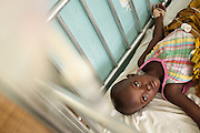 Ghana: 25 April 2012, Seida Alhassane, 4, lies ona bed as she recovers from diarrhea at the Princess Marie Louise Children's hospital in Accra. The GAVI Alliance is a public-private partnership that brings together developing country and donor governments, WHO, UNICEF, the World Bank, the vaccine industry in both industrialised and developing countries, research and technical agencies, civil society, the Bill & Melinda Gates Foundation and other private philanthropists.  Set up in 2000 as the Global Alliance for Vaccines and Immunisation, GAVI's mission is to save children's lives and protect people's health by increasing access to immunisation in the world's poorest countries.