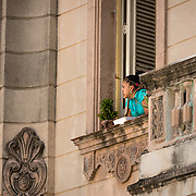 Cuban woman on the balcony of her apartment in Havana