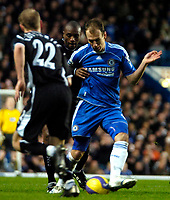 Photo: Ed Godden/Sportsbeat Images.<br />Chelsea v Wigan Athletic. The Barclays Premiership. 13/01/2007. Wigan's Emerson Boyce (centre), tackles Arjen Robben from behind.