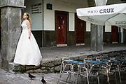 Porto, Portugal, 4 jun 2013, Porto Cruz, A bride is posing for her wedding pictures in her weddingdress. PHOTO © Christophe Vander Eecken