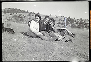 young adult male with two females enjoying a day out 1950s