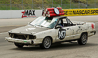 The Brooklyn Bomb Squad's 1990 Audi 100 Quatro is set to blow at just past 3pm Sunday afternoon after the conclusion of 24 Hours of Lemons race at New Hampshire Motor Speedway in Loudon.  (Karen Bobotas/for the Concord Monitor)