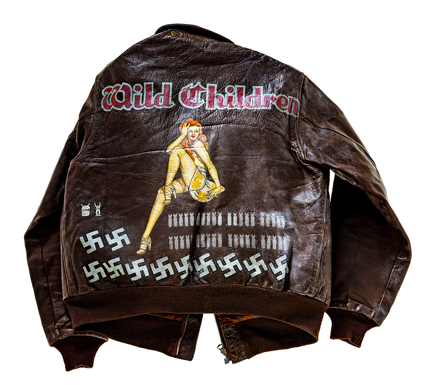 This jacket was owned by Lt. Col. (later Brig. Gen.) Robert W. Waltz, of the 390th Bomb Group.  Each bomb represents a mission flown and each swastika is an enemy aircraft shot down.  The flour sack and POW symbols are for Operation Chowhound and POW evacuation missions at the end of WWII.