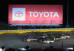 March 1, 2019 - Las Vegas, NV, U.S. - LAS VEGAS, NV - MARCH 01: Kyle Busch (51) KBM Toyota Tundra, Anthony Alfredo (15) DGR-Crosley Toyota Tundra, Ross Chastain (45) Niece Motorsports Chevrolet Silverado, Grant Enfinger (98) Curb Motorsports Ford F-150, and Harrison Burton (18) Kyle Busch Motorsports (KBM) Toyota Tundra drive under the Toyota billboard in turn 2 during the NASCAR Gander Outdoors Truck Series Strat 200 on March 01, 2019, at Las Vegas Motor Speedway in Las Vegas, NV. (Photo by Chris Williams/Icon Sportswire) (Credit Image: © Chris Williams/Icon SMI via ZUMA Press)