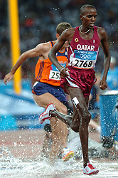 Simon Vroemen, Musa Amer QAT in action during Olympics Games Athletics day 12 on August 24, 2004 in Olympic Stadion Spyridon Louis, Athens.