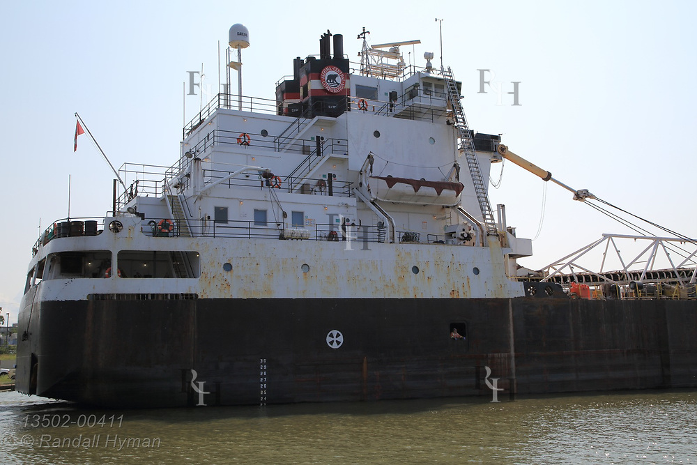 Freighter exits harbor on Lake Erie at Lorain, OH.