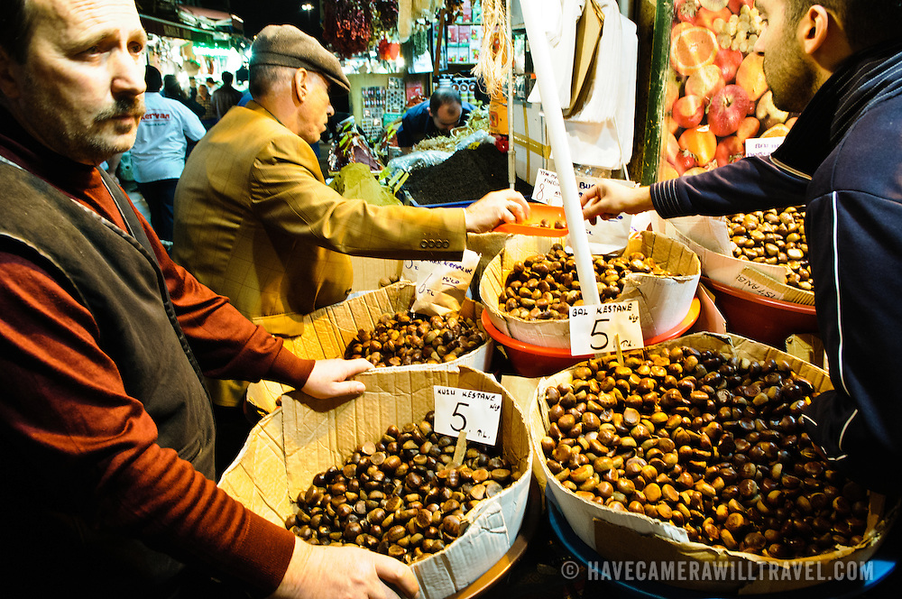 Customers buy chestnuts, pistachios, and other nuts next to the Spice Bazaar (also known as the Egyption Bazaar) in Istanbul, Turkey.