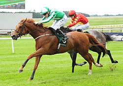 Mr Lupton ridden by Jamie Spencer goes on to win The Weatherbys Ireland Greenland Stakes during day one of the Curragh Spring Festival at Curragh Racecourse, County Kildare
