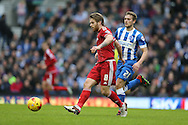 Middlesbrough FC midfielder Adam Clayton gets away from Brighton striker (on loan from Manchester United), James Wilson (21) during the Sky Bet Championship match between Brighton and Hove Albion and Middlesbrough at the American Express Community Stadium, Brighton and Hove, England on 19 December 2015.