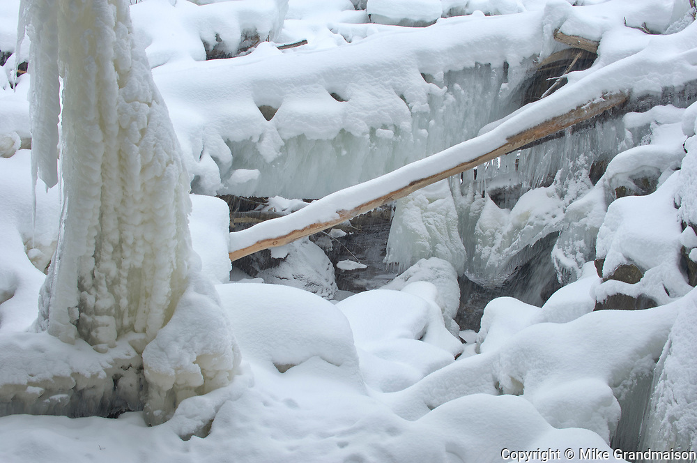 Ice on trees and The North Branch of the Muskoka River at Wilson's Falls in winter. Muskoka Country.<br />Bracebridge<br />Ontario<br />Canada