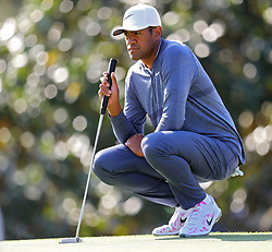 April 6, 2018 - Augusta, GA, USA - Tony Finau lines up his par putt on the first hole, which he bogey'd,during the second round of the Masters at Augusta National Golf Club on Friday, April 6, 2018, in Augusta, Ga. (Credit Image: © Curtis Compton/TNS via ZUMA Wire)