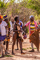 "The Hamar are known for their unique custom of ""bull jumping,"" which initiates a boy into manhood. The boy must run back and forth (nude) twice across the backs of a row of bulls or castrated steers. Omo Valley, Ethiopia."
