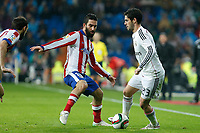 Real Madrid´s Isco (R) and Atletico de Madrid´s Arda Turan during Spanish King´s Cup match at Santiago Bernabeu stadium in Madrid, Spain. January 15, 2015. (ALTERPHOTOS/Victor Blanco)