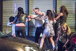 © Licensed to London News Pictures . 01/01/2017 . Manchester , UK . A fight involving several men and women breaks out on King Street West . People on a night out in Manchester City Centre , after midnight on January 1st 2017 . Photo credit : Joel Goodman/LNP