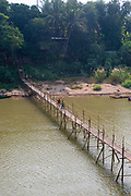 Walking across a bamboo bridge, Luang Prabang, Laos.