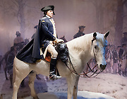 Revolutionary War General George Washington is portrayed at age 45 mounted on a horse in a sculpture at the Donald W. Reynolds Museum and Education Center at Mount Vernon, Virginia, USA. George Washington (1732-1799) was one of the Founding Fathers of the United States of America (USA), serving as the commander-in-chief of the Continental Army during the American Revolutionary War, presiding over the convention that drafted the Constitution in 1787, and serving as the first President of the United States (1789-1797). Named in his honor are Washington, D.C. (the District of Columbia, capital of the United States) and the State of Washington on the Pacific Coast. On banks of the Potomac River, Mount Vernon was the plantation home of George Washington. Mount Vernon estate was designated a National Historic Landmark in 1960 and is owned and maintained in trust by The Mount Vernon Ladies' Association.