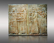 Stone relief sculptured panel of two servants. Facade L. Inv AO 19879 from Dur Sharrukin the palace of Assyrian king Sargon II at Khorsabad, 713-706 BC.  Louvre Museum Room 4 , Paris