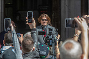 American actor Johnny Depp wave at his supporters as he arrives the High Court in London on Tuesday morning, July 21, 2020. Amber Heard started Monday to give evidence at the High Court in London as part of Johnny Depp's libel case against The Sun over allegations of domestic violence during the couple's relationship. (VXP Photo/ Erica Dezonne)