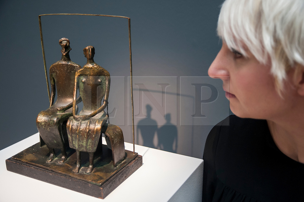 """© Licensed to London News Pictures. 28/01/2016. London, UK.   """"Maquette for King and Queen"""" by Henry Moore (est. £0.8-1.2m), on display at Sotheby's preview of its upcoming Impressionist, Modern & Surrealist art sale on 3 February featuring works by some of the most important artists of the 20th century.  The combined total of the evening sale is expected to exceed £100m. Photo credit : Stephen Chung/LNP"""