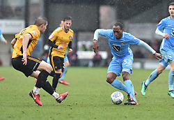 Newport County's Matty Dolan and Coventry City's Kyle Reid (right) battle for the ball