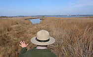 03/13/07.United States Park Ranger Chris Seymour talks about the marsh land on the bayside of Assateague Island during a walking tour of the wilderness area on the north side of the island. .Photo by Peter J. Casey