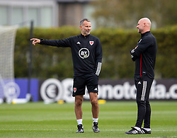 CARDIFF, WALES - Wednesday, September 2, 2020: Wales' manager Ryan Giggs (L) chats with assistant coach Robert Page during a training session at the Vale Resort ahead of the UEFA Nations League Group Stage League B Group 4 match between Finland and Wales. (Pic by David Rawcliffe/Propaganda)