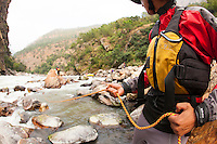 Lining rafts down unrunnable secion of  the Drangme Chhu (river) in Bhutan.