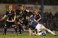 QPR's Wayne Routledge is tackled by Cardiff's Roger Johnson. Coca Cola championship, Cardiff City v QPR match at Ninian Park in Cardiff on Wed 25th Feb 2009. pic by Andrew Orchard, Andrew Orchard sports photography.