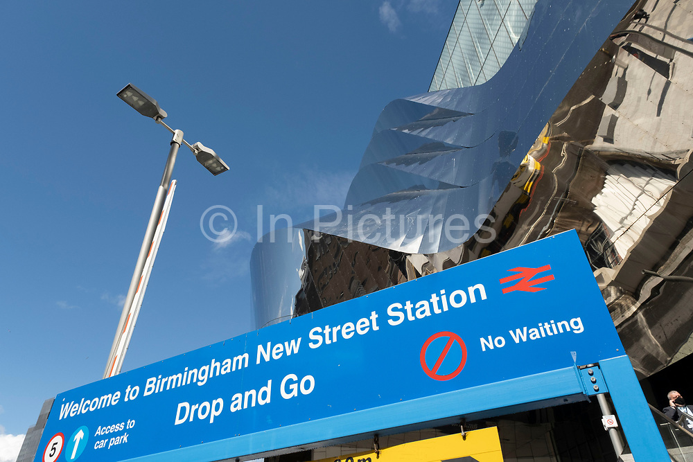 Metal architectural exterior of Grand Central station on 18th May 2021 in Birmingham, United Kingdom. Grand Central is a shopping centre located in Birmingham, England, that opened on 24 September 2015. It is currently owned by Hammerson and CPPIB. The original centre was built in 1971 as part of the reconstruction of Birmingham New Street station. It was known as the Birmingham Shopping Centre before being renamed as The Pallasades. As part of the New Street Station Gateway Plus redevelopment, Grand Central underwent a major overhaul.